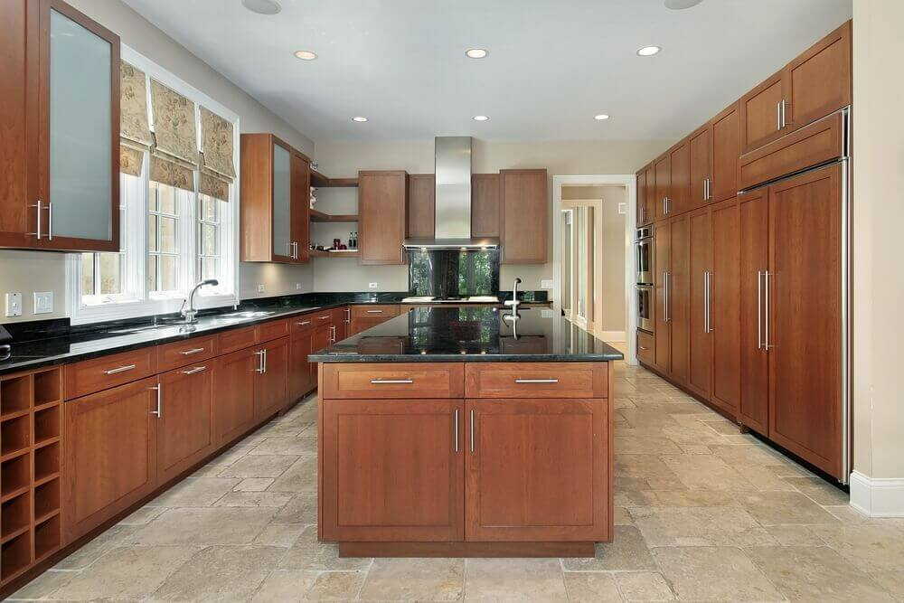 Contemporary spacious U-shaped kitchen with large island.