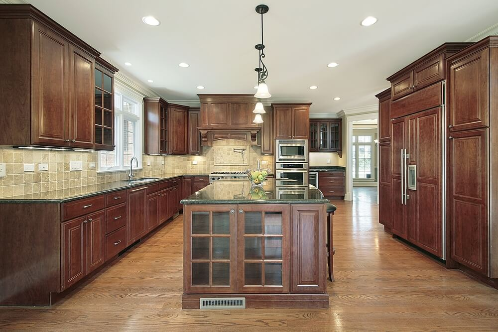 Light hardwood flooring and dark wooden cabinetry compliment each