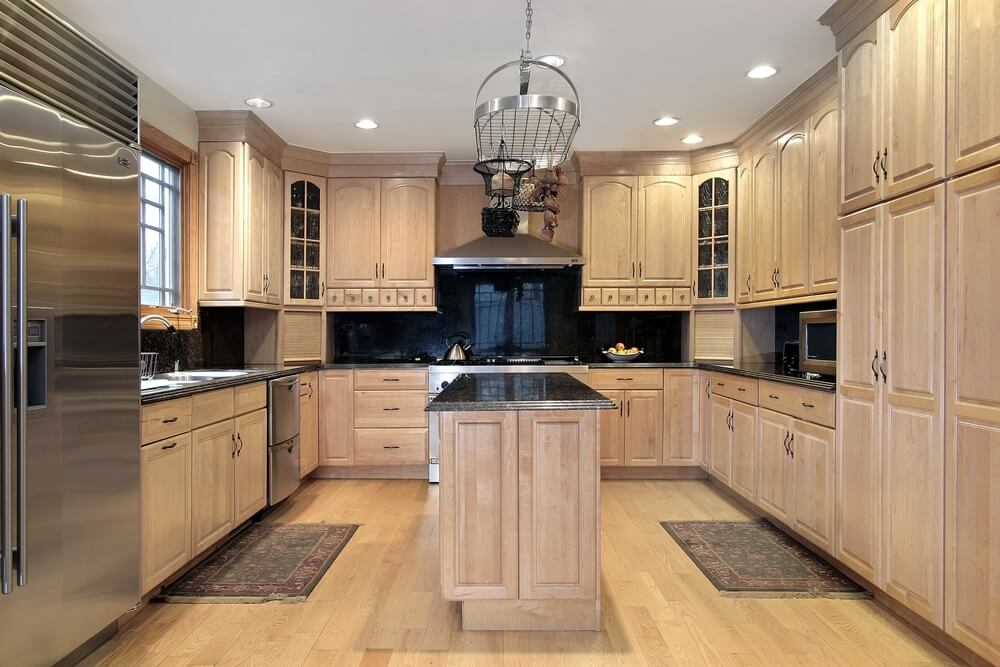 Wonderful Large Enclosed Kitchen With Custom Wood Cabinets (floor To Ceiling) Lining  Three