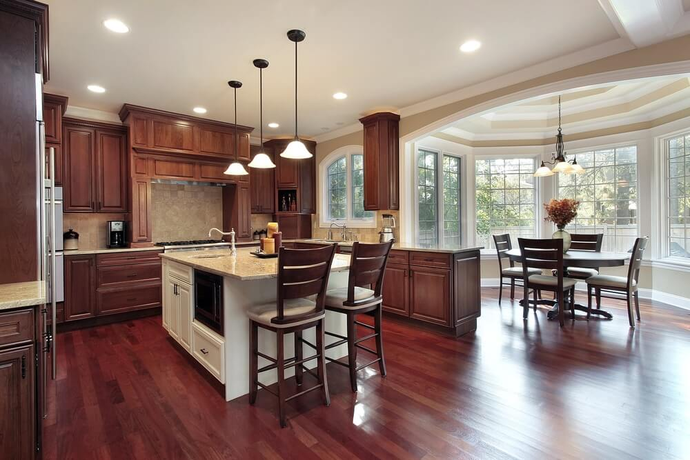 Cherry Hardwood Flooring cherry wood flooring Cherry Wood Flooring And Natural Toned Wood Cabinetry Warm Up This Kitchen Featuring Attached Dining
