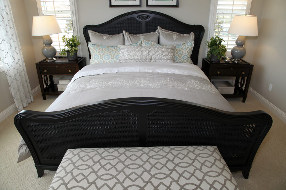 small bedroom with black wicker bed frame featuring a clamshell design - Wicker Bed Frame