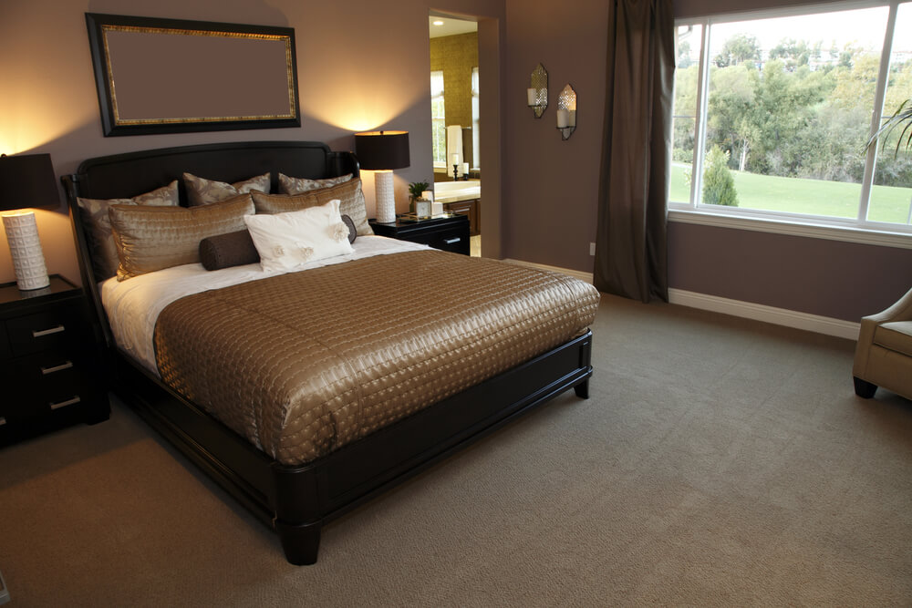 Solid Dark Traditional Bed Frame Features In This Bedroom With Caramel Colored Bedding Accented By