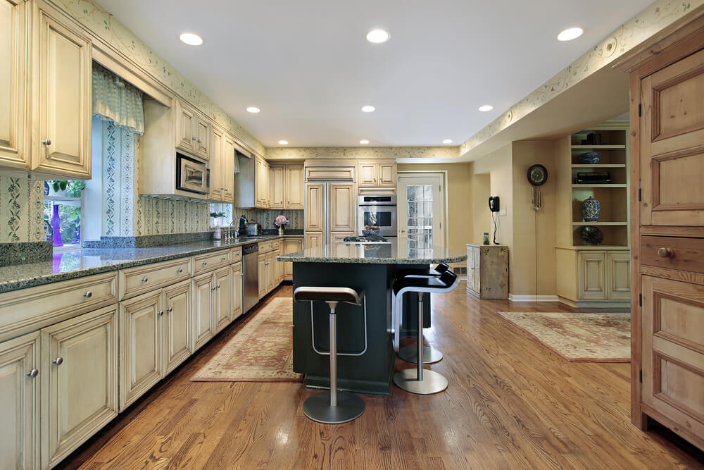 Both The Unvarnished And Painted Wood Styles In This Kitchen Compliment Natural Light Tones Of