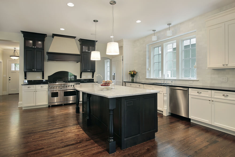 White Kitchen With Extensive Foot Print Main White Cabinets And Dark Counter Tops Wrap Around