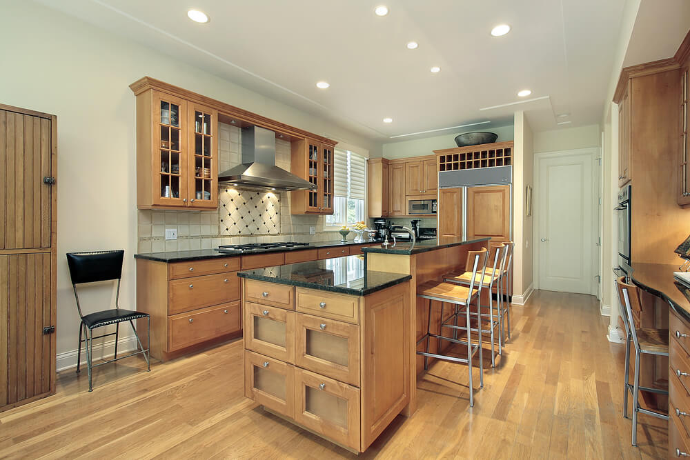 awesome Kitchen With Light Wood Cabinets #2: Recessed lighting helps keep things minimal in this bright, large kitchen.