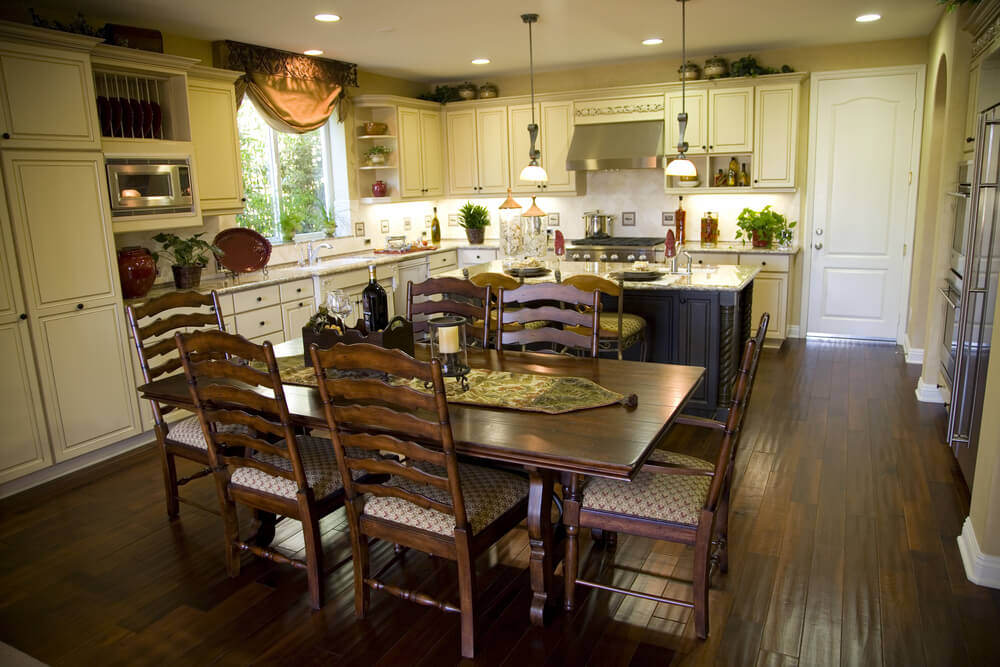 Another Example Of A Kitchen With An Island Dining Bar Plus Separate Table And Area