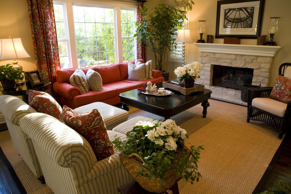 Living Room Making Use Of A Bold Color To Punctuate Natural Earth Tones.