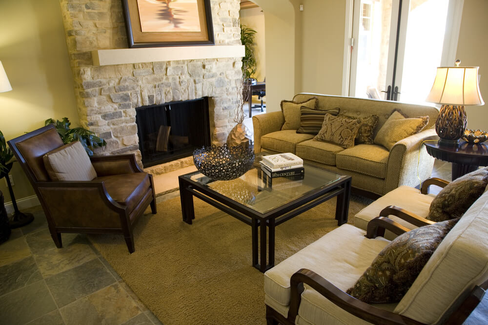 A large stone fireplace with decorative mantle dominates this cozy living room.