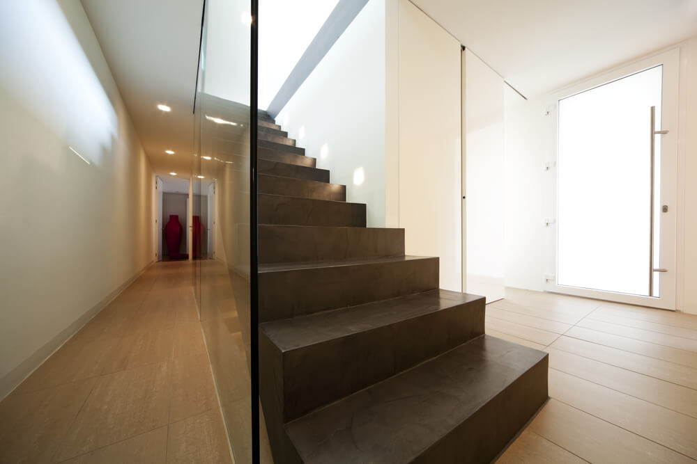 Straight staircase with glass wall.