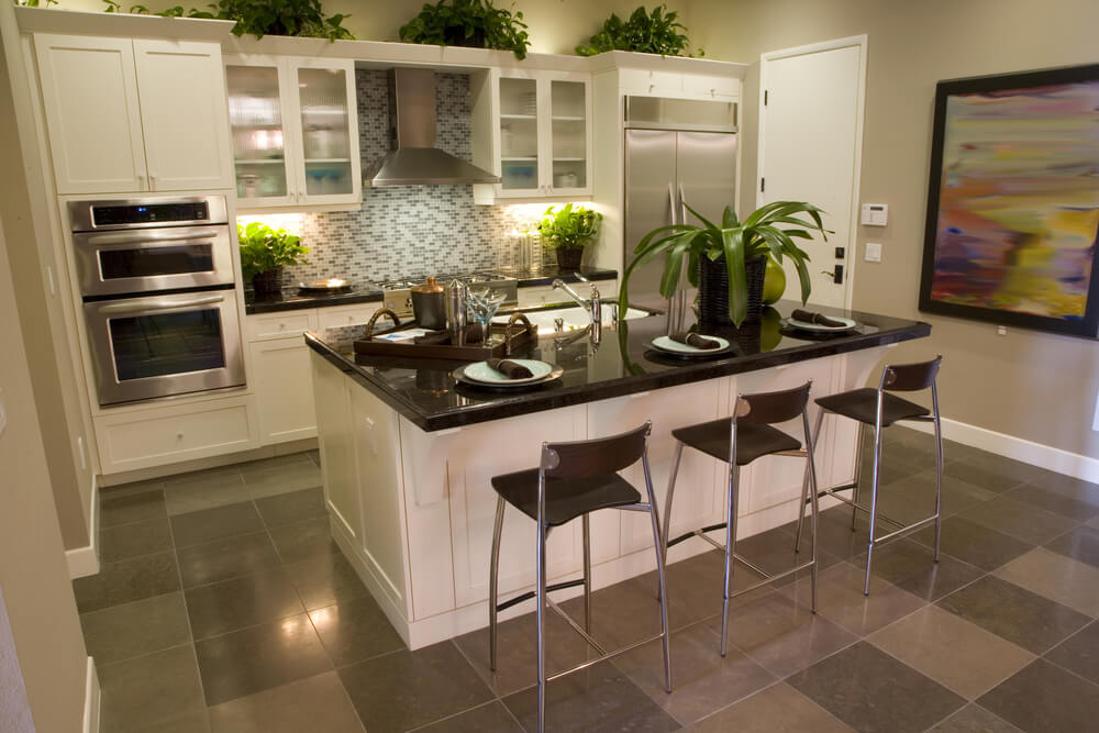 Modern White Galley Kitchen With Rectangle Island With An Eat In Counter.