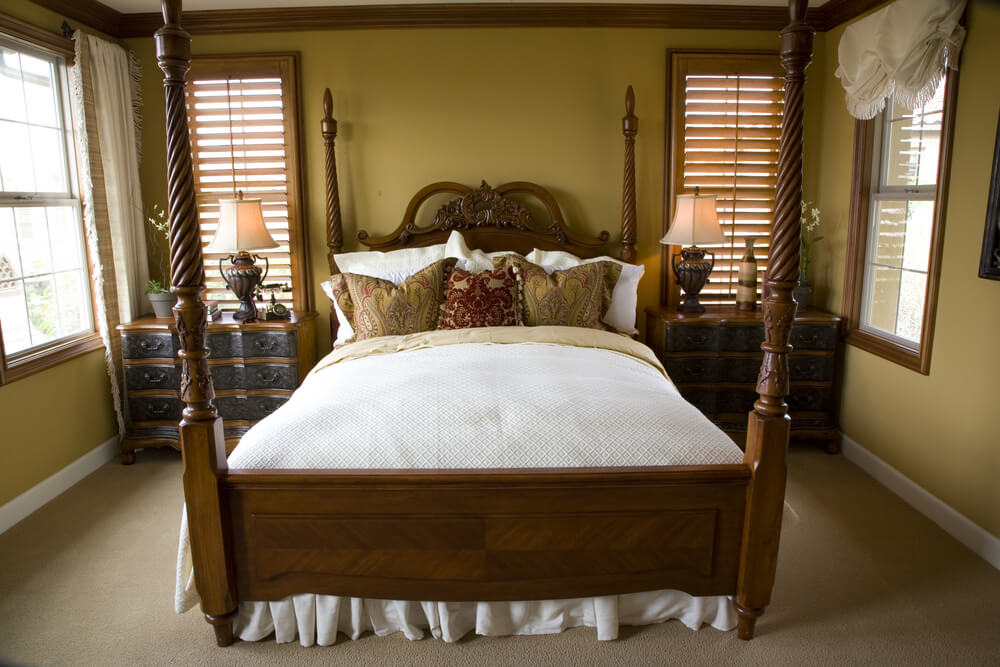makes use of its space with classic wood bed frame with spiral posts