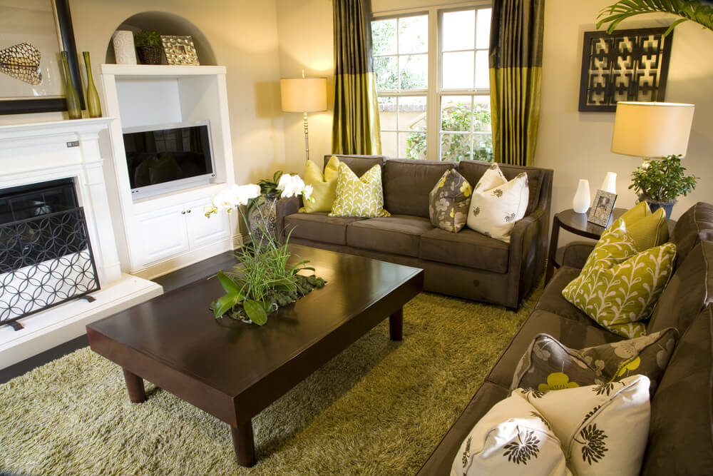 Citrus colors draw this room together with earth toned couches and coffee table.