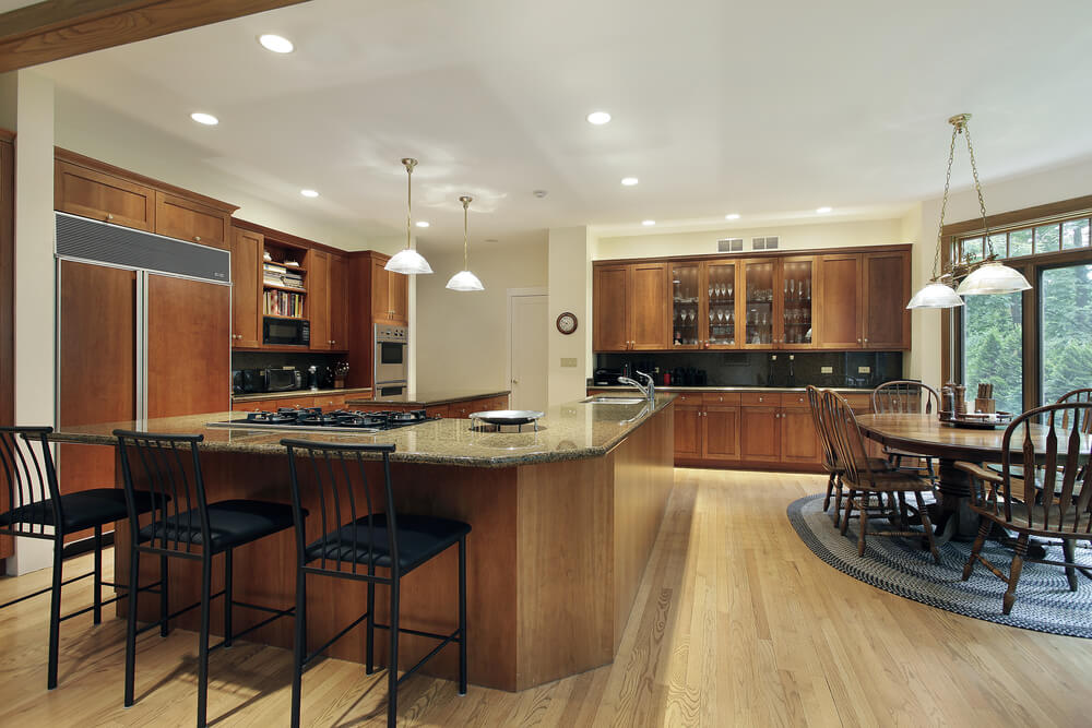 Large Kitchen With Equally Large L Shaped Matching Island Kitchen Is Split Up Into