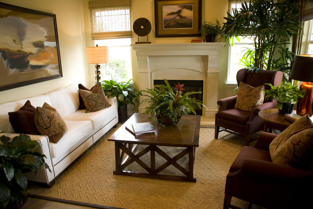 This room features a variety of colors, made cohesive by brown pillows distributed on the furniture.