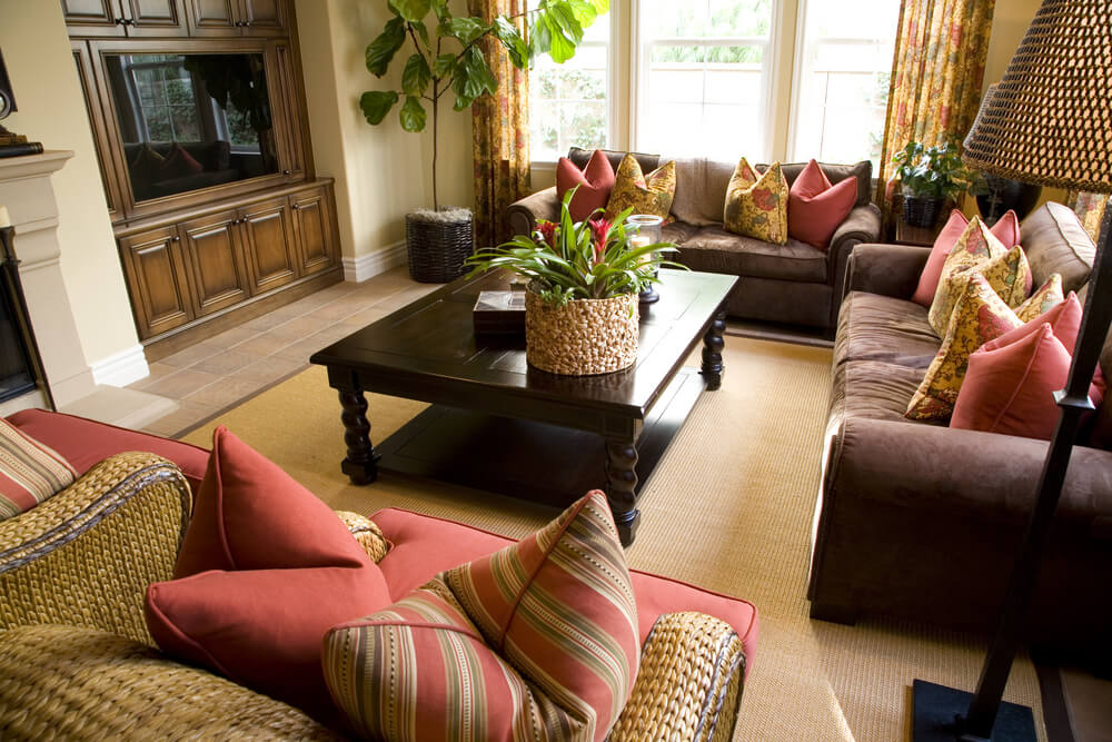 This space features a strong theme of red and tan colors on nearly all soft surfaces.