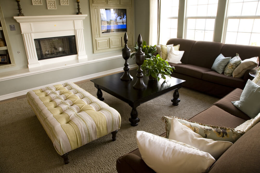 living room with two dark brown sofas, square dark brown coffee table ...