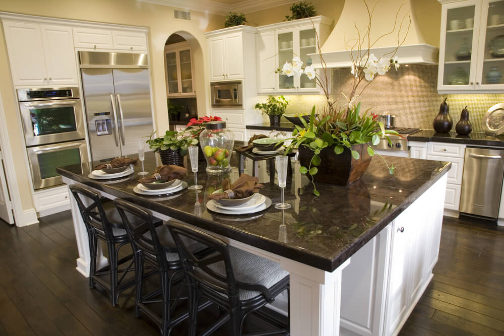 White Kitchen Design With Dining Island For Three People.