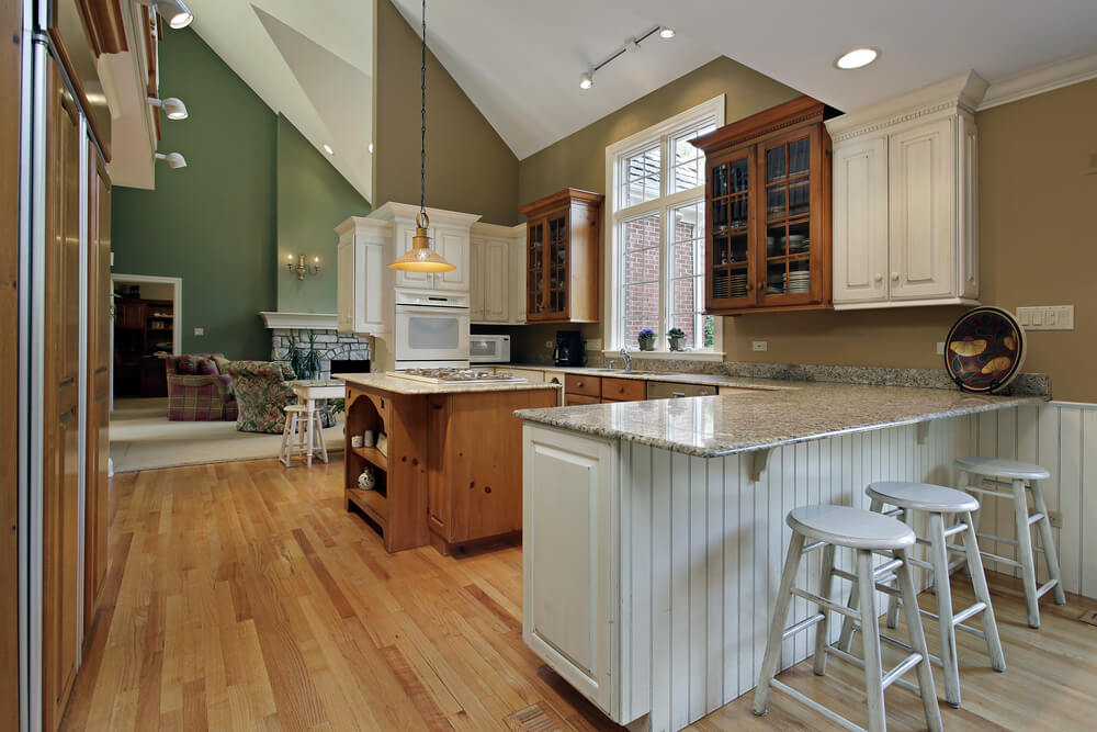 Cathedral Ceiling Is The Star Of This Large Kitchen Which Includes White And Natural Wood Cabinetry