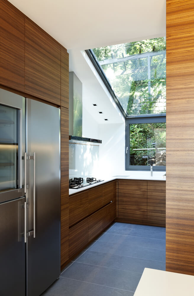 Tiny Natural Wood Kitchen With Large Window And Skylight Sloped Ceiling Is Partially Glass