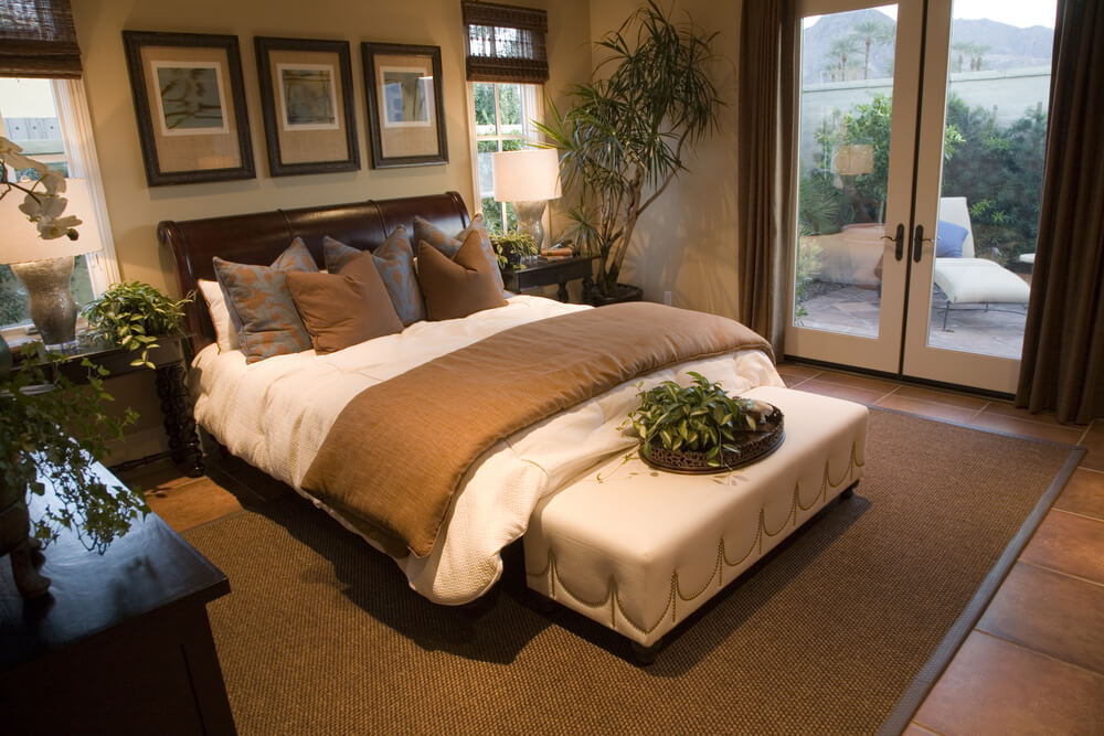 Bedroom featuring walk-out patio through glass French doors.