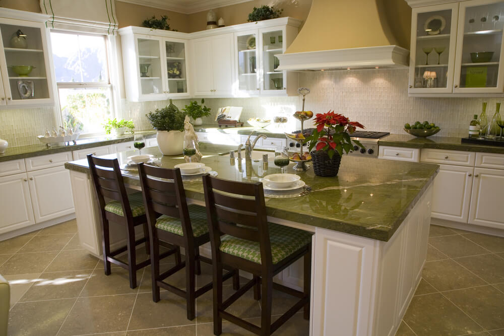 white and green kitchen with matching island with seating for three people. Interior Design Ideas. Home Design Ideas