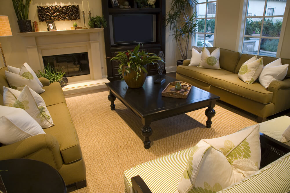 spacious living room in green white and brown color scheme two matching green sofas