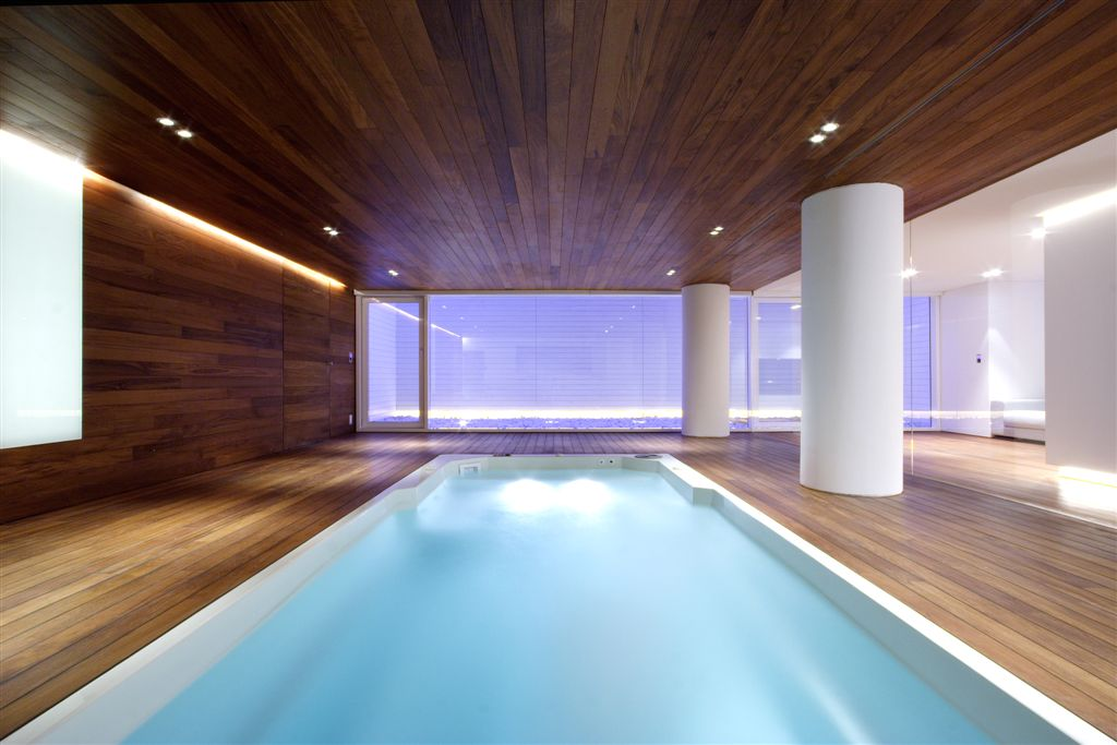Long view of pool room, showcasing matching wood paneling on nearly every surface.