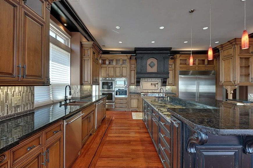 Extensive space in this wood floored kitchen is filled with extra long   dark wood island. 40 Uber Luxurious Custom Contemporary Kitchen Designs