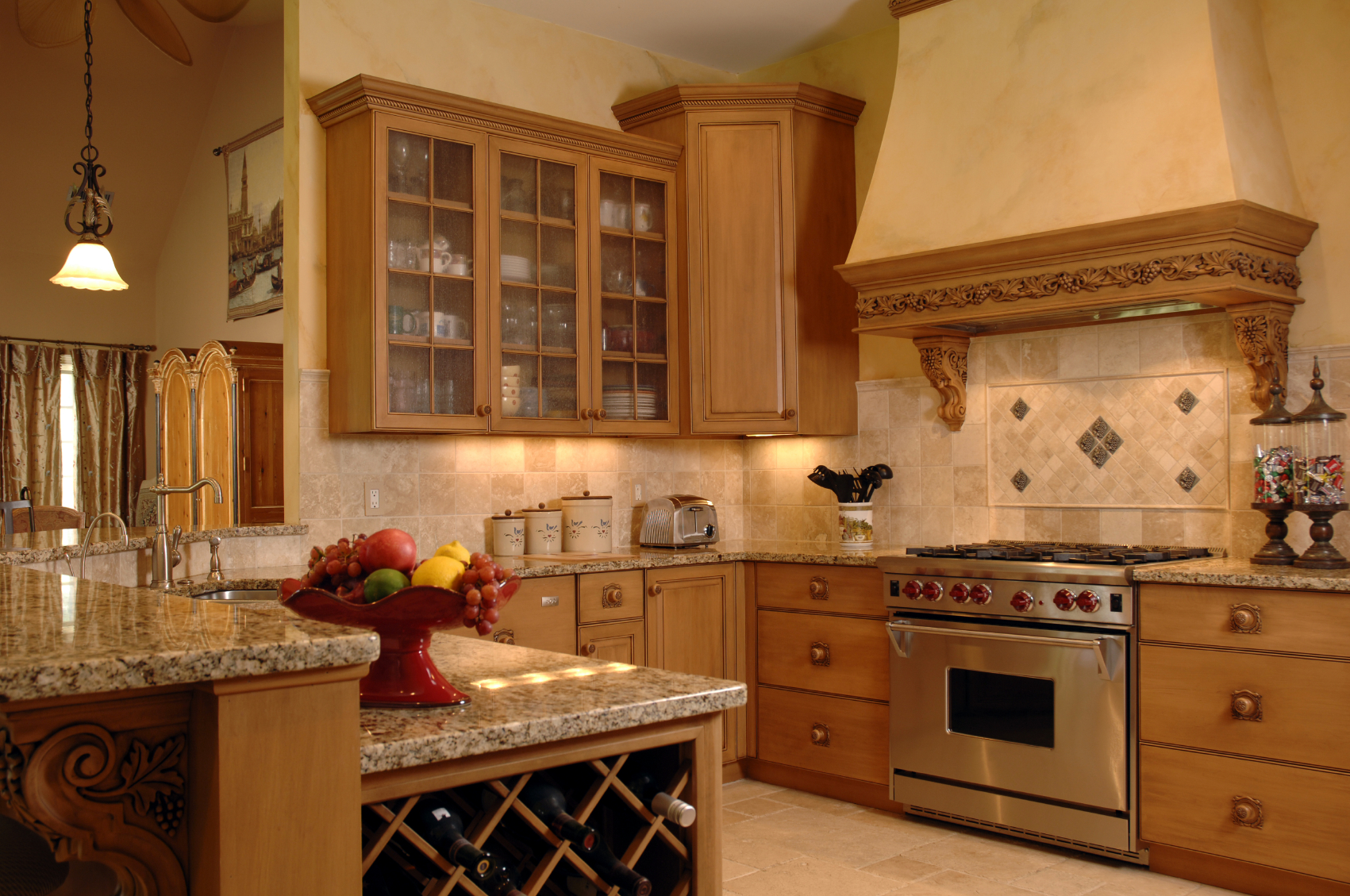 warm sandy tones unify this kitchen with large tile backsplash