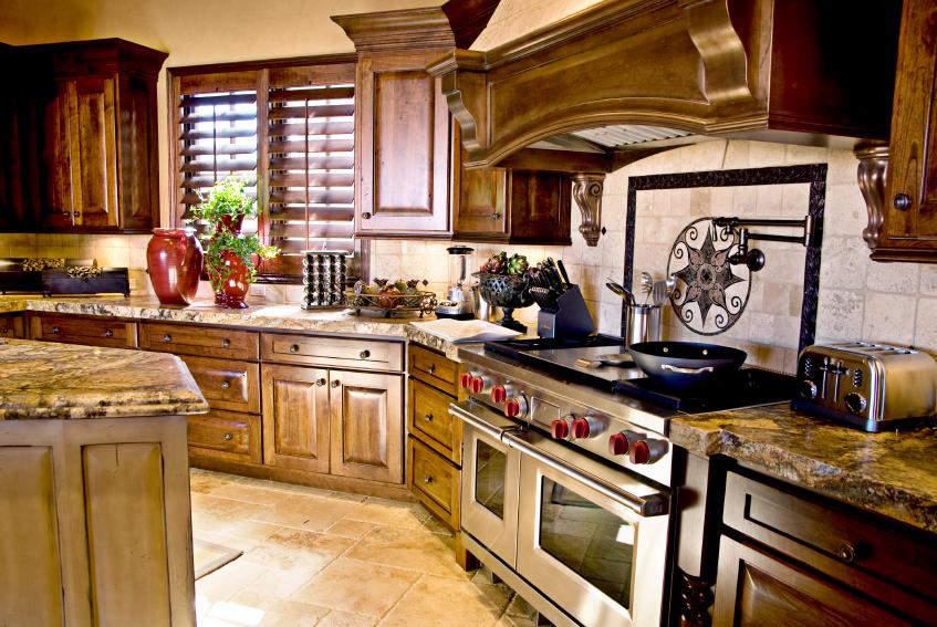 Intricate detail throughout this cozy kitchen: dark marbled ...