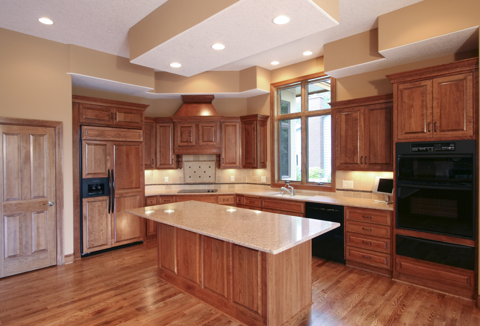 warm wood tone throughout this entire kitchen ix contrasted with beige
