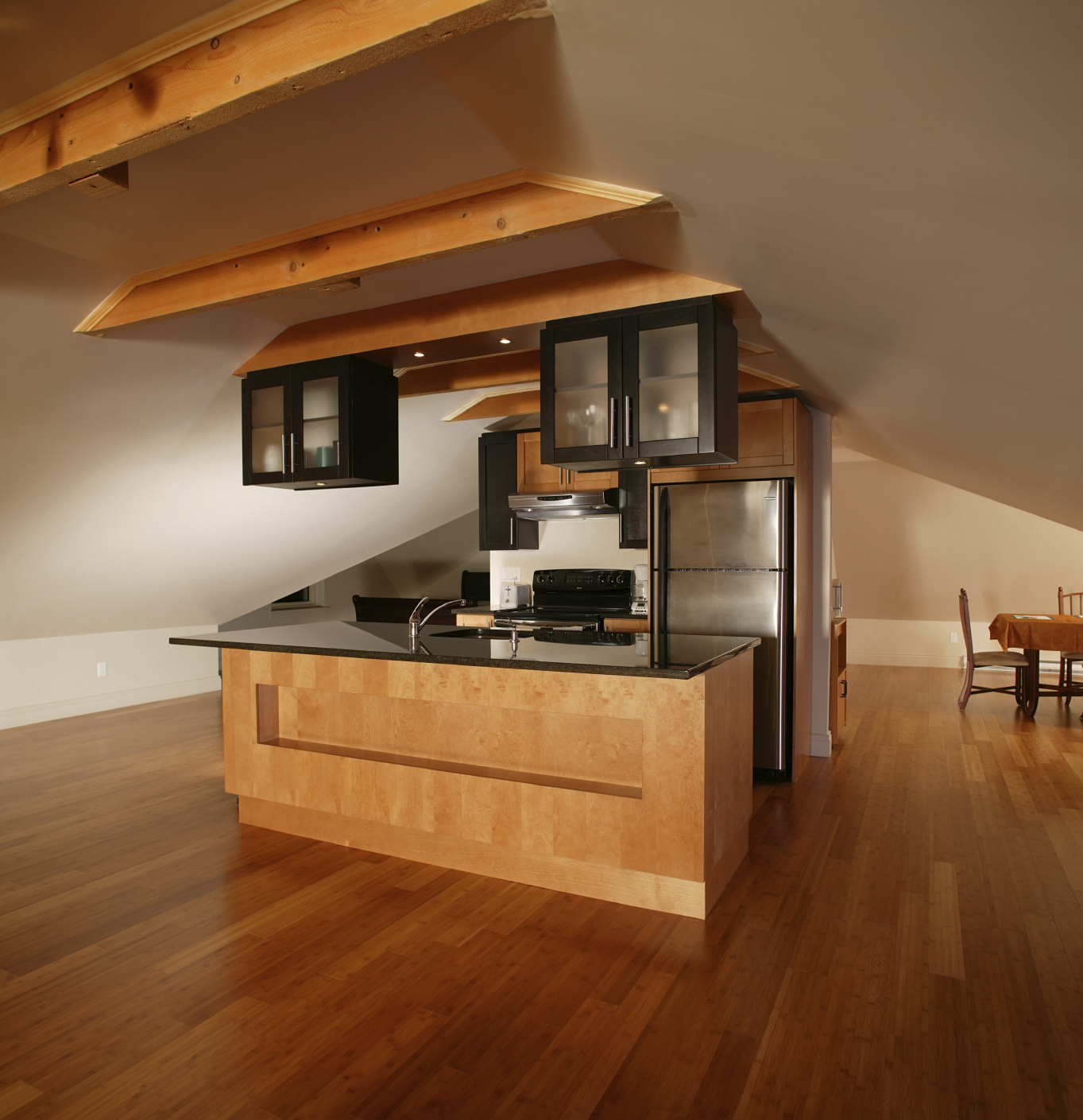 Natural wood hues throughout this large kitchen featuring commanding