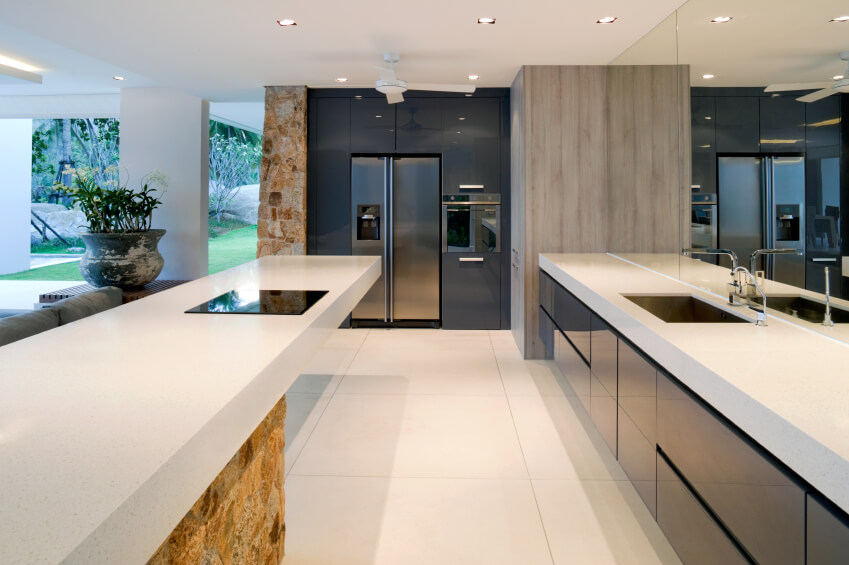 White Countertops And Matching Floor Brightens This Open Kitchen, Along  With Stone Island And Wall Part 69