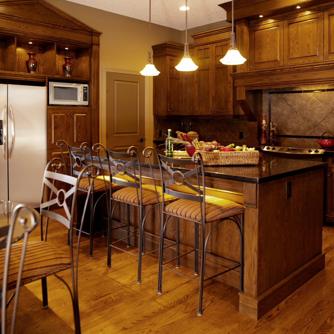 Cozy Kitchen Awash In Warm Natural Wood Tones Featuring Black