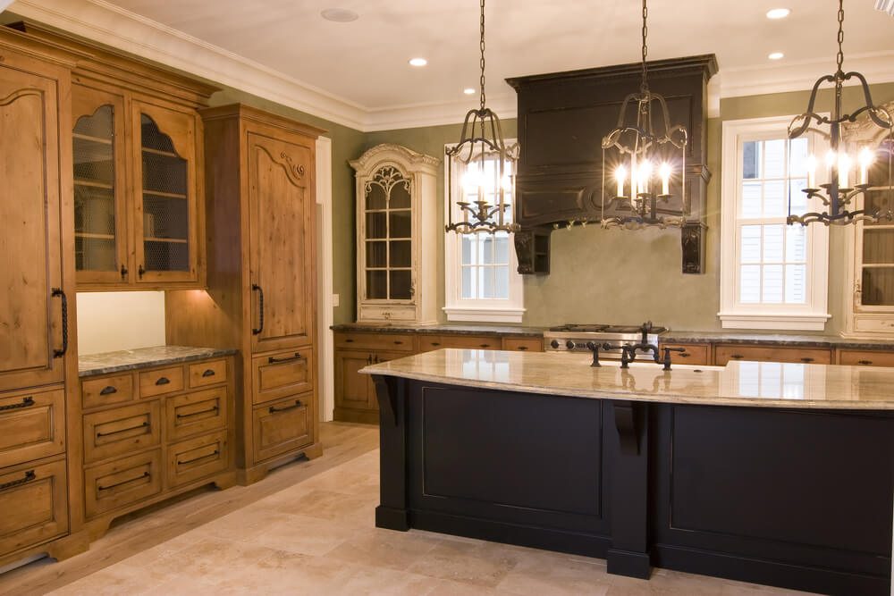 Immense Black Wood Island With Light Marble Countertop Dominates This  Kitchen, Featuring An Open Space