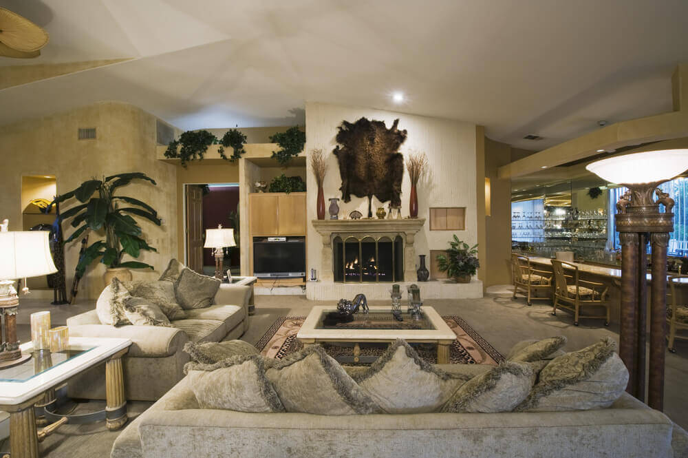 This Room Features A Grey And Gold Palette Marble Fireplace Full Mirror