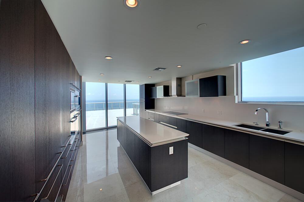 Long, Open Space Here Is Punctuated By Large Dark Wood And White Countertop  Island, Part 42