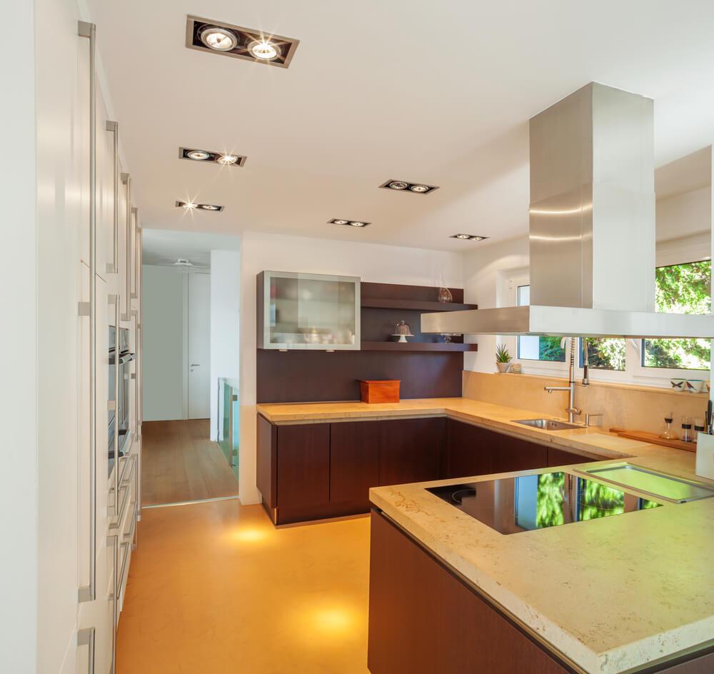 Bright toned kitchen is flush with yellow flooring  beige marble  countertops  natural dark wood. 60 Ultra Modern Custom Kitchen Designs  Part 1