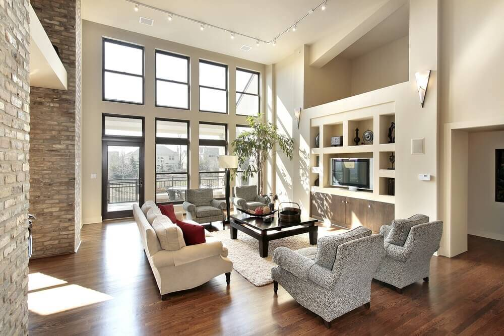 2 story living room with large window and spacious seating - Traditional Living Room Design Ideas