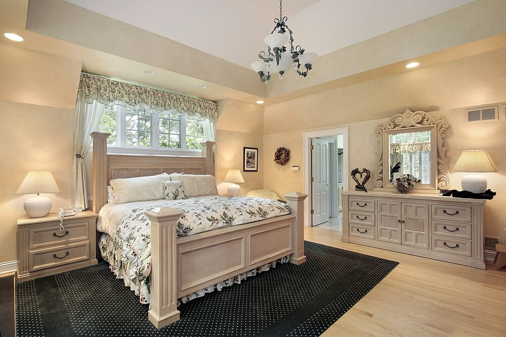 light wood tones cover this bedroom featuring matching side table dresser and bed frame