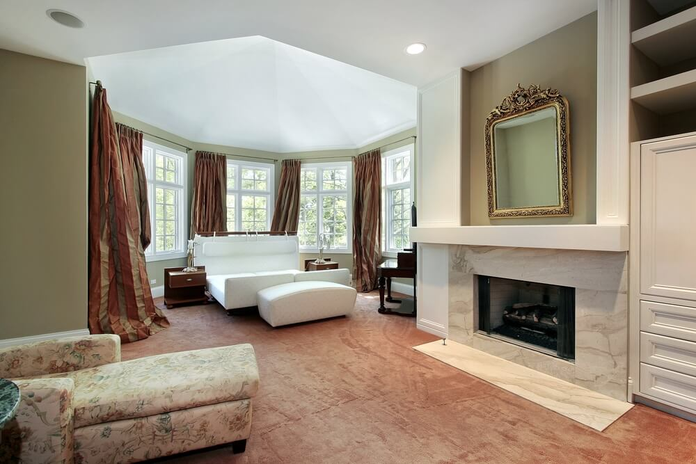 Uniquely Shaped Bedroom Featuring Marble Hearth And Bed Area In Attached Rotunda