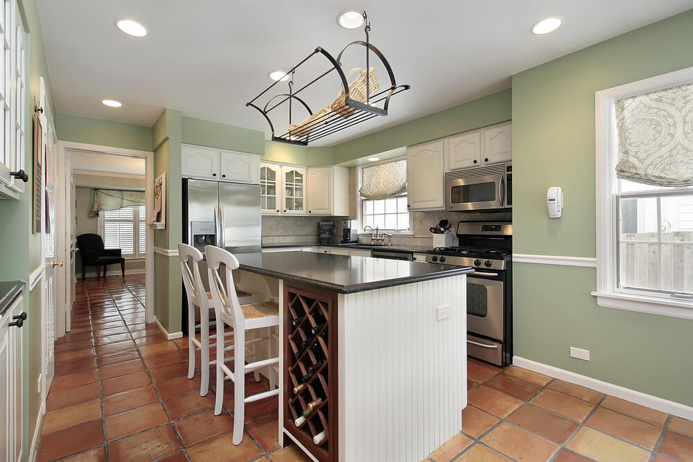 example of light green wall paint featuring in an open, bright kitchen