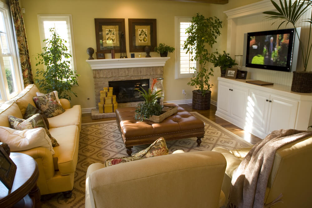 This Living Room Is Filled Detail Light Yellow Fabric Chairs And Couchlarge Leather