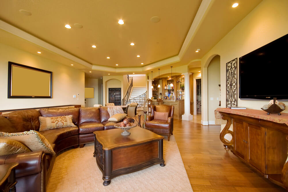 heres another large open space featuring raised ceiling with recessed lighting bulging leather sectional - Open Space Living Room Ideas