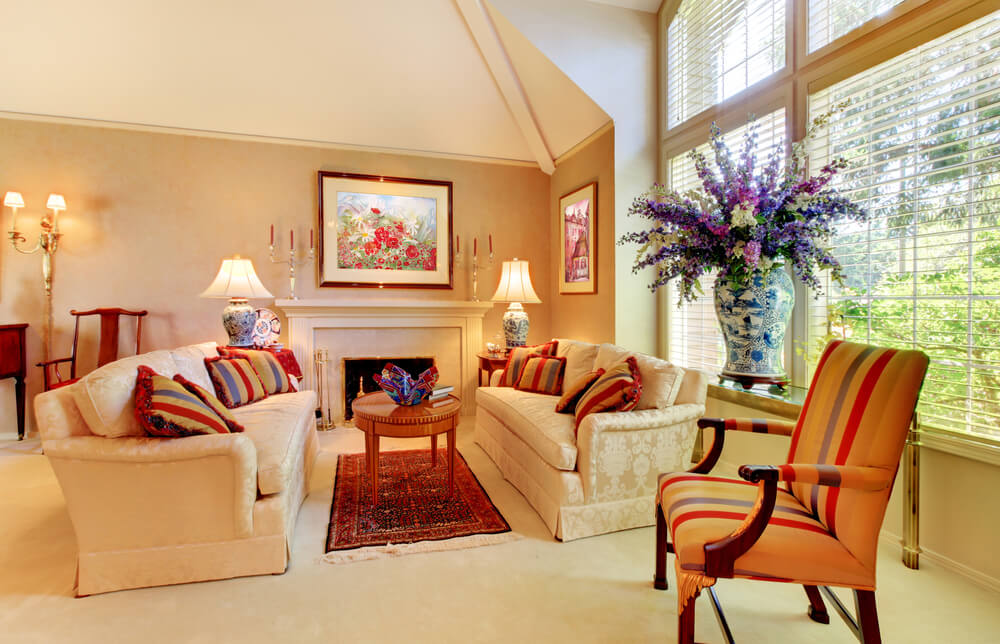 Bright Living Room Featuring An Array Of Striped Color On Chair And Pillows Rich Patterned