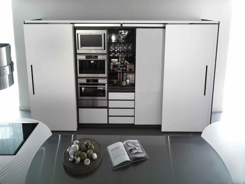 Another Modern Styled Kitchen, Showcasing An Efficient Use Of Space With  Sliding White Doors Able