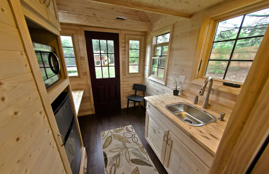 full view of interior of tinier home highlighting desk space on left - Tiny House Inside