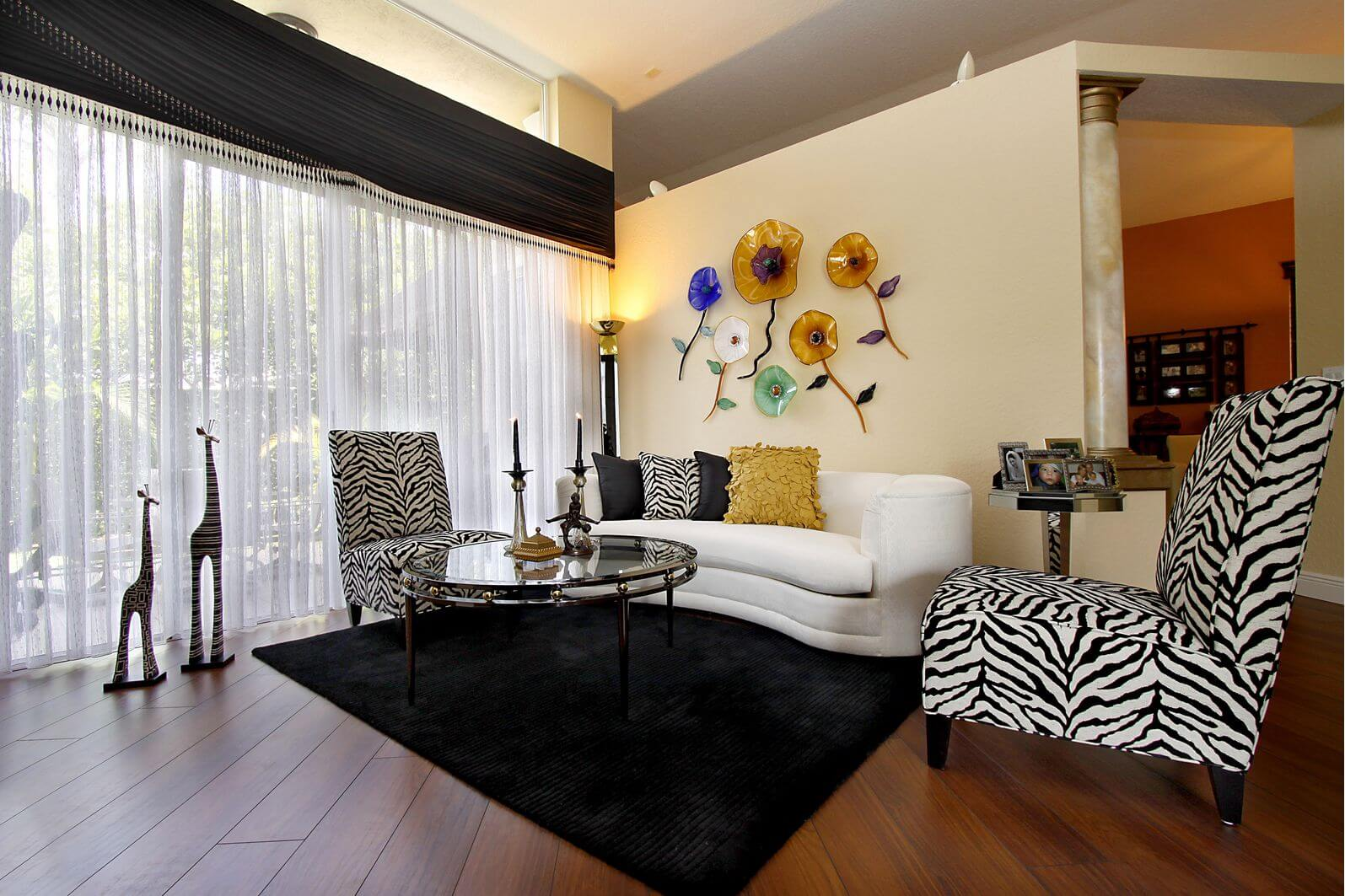 Superbe Small Living Room With 2 Zebra Print Armless Chairs, One Small White Sofa,  Glass