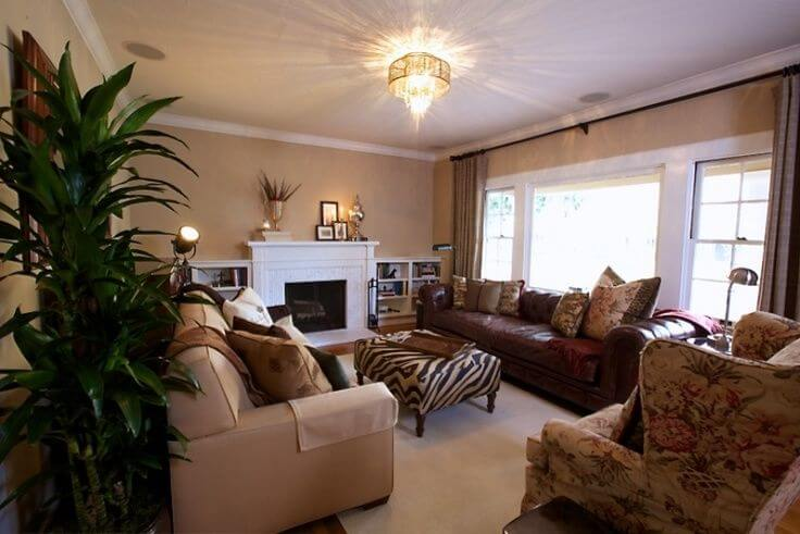 Heres a large formal living room with a large ruby red leather sofa light brown