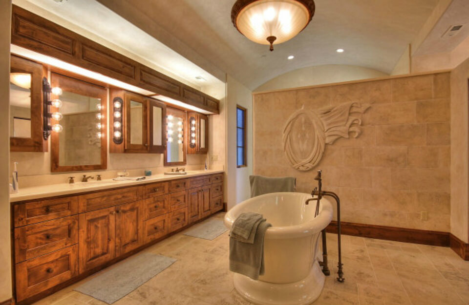 Interesting master bath design with a large free-standing tub dead-center of the room.